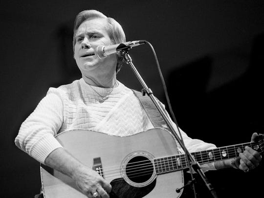 George Jones, the unquestioned star of the CBS Records show, performs for his fans during the Fan Fair event June 9, 1987, at the Tennessee State Fairgrounds.