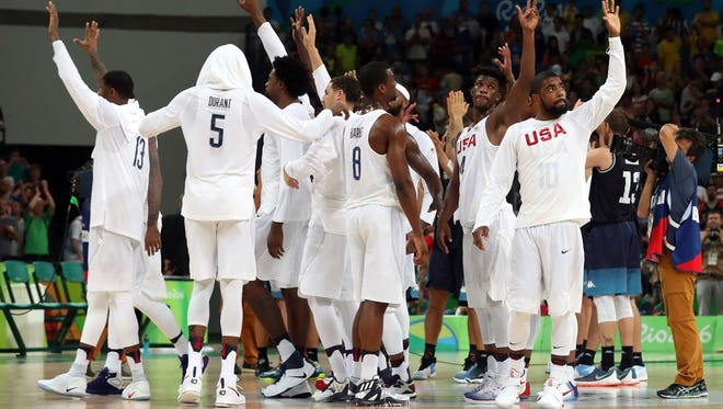 Team USA waves to the fans after the game against Argentina during the men's basketball quarterfinals in the Rio 2016 Summer Olympic Games at Carioca Arena 1.
