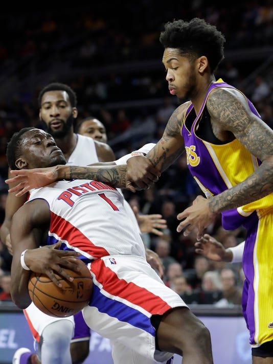 Detroit Pistons guard Reggie Jackson (1) is fouled by Los Angeles Lakers forward Brandon Ingram during the first half of an NBA basketball game, Wednesday, Feb. 8, 2017, in Auburn Hills, Mich. (AP Photo/Carlos Osorio)
