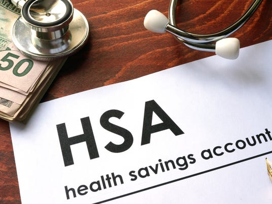 Paper with words  health savings account (HSA) on a table.