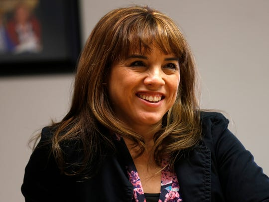 Christine Garcia, outgoing CEO of Big Brothers Big Sisters of San Juan County, smiles during an interview Friday at the nonprofit organization's office in Farmington.