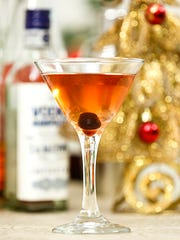 Statesman Journal business of food and drink reporter Brooke Jackson-Glidden's Spiced Vodka Cranberry cocktail is a twist on a seasonal favorite, with the addition of apple cider and a cherry.