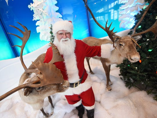 Santa Claus keeps a busy schedule this time of year, including posing for photos and listening to the Christmas wishes of the young and the young-at-heart at Bass Pro Shops in Pearl.