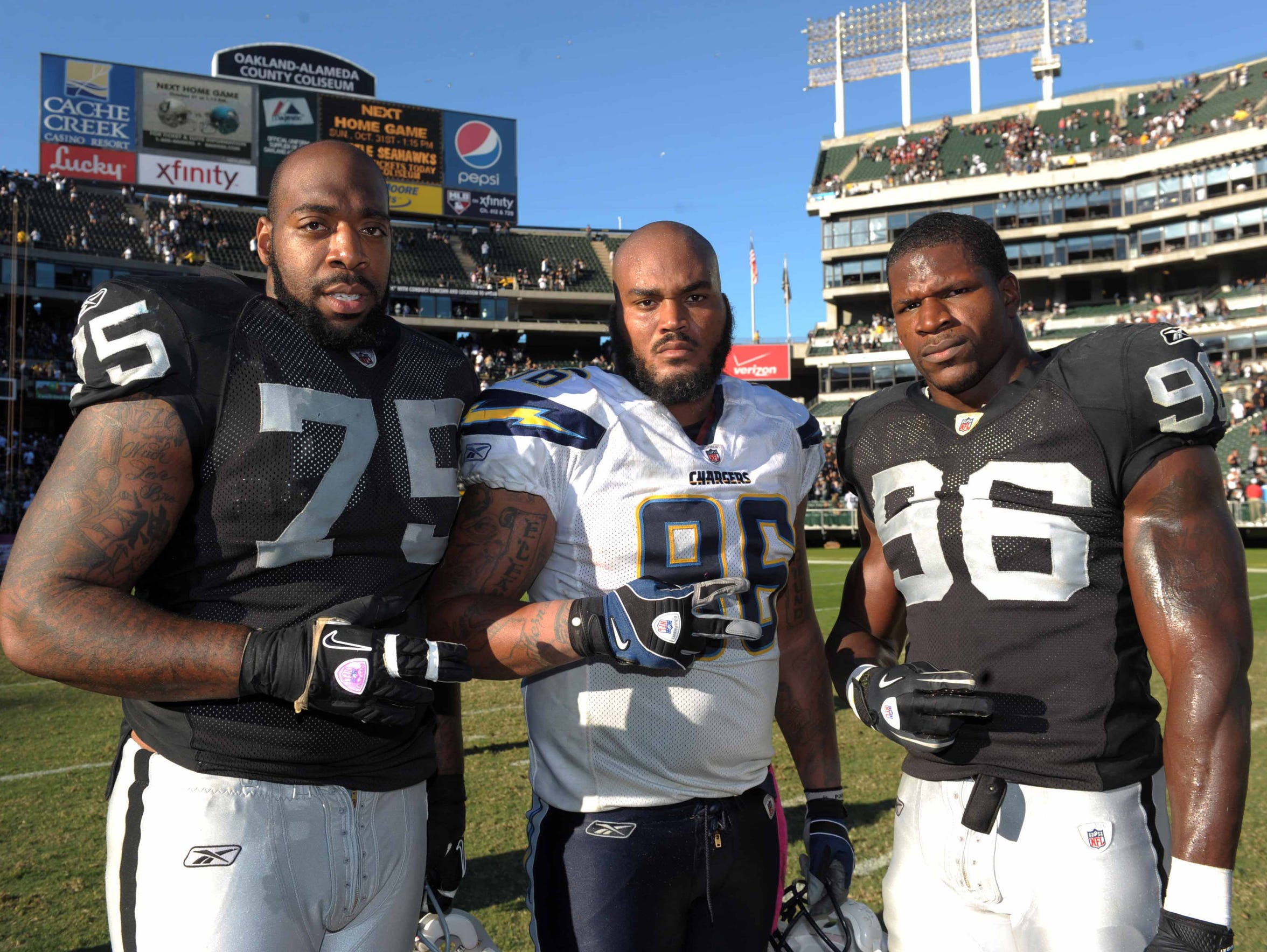 San Diego Chargers defensive end Travis Johnson (center)