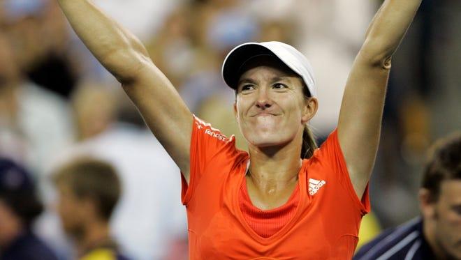 In this Sept. 8, 2007, file photo, Justine Henin of Belgium celebrates her two-set victory over Svetlana Kuznetsova of Russia at the U.S. Open.