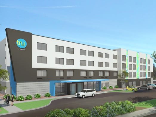 A rendering of the exterior of a Tru by Hilton, a new