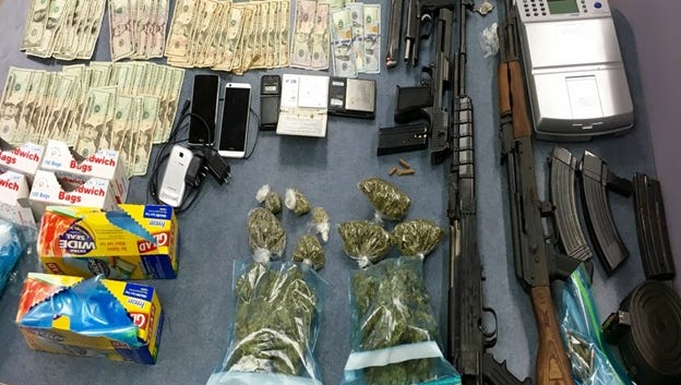 Jackson police found guns, money, and drugs in a bust on Bailey Avenue Wednesday.