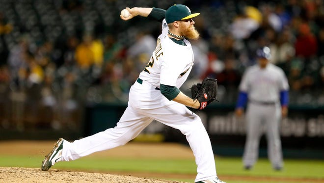 Oakland Athletics relief pitcher Sean Doolittle (62) pitches during the ninth inning against the Texas Rangers at O.co Coliseum. Oakland Athletics won 10-6.