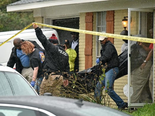 Vicksburg police carry out the body of escaped murder