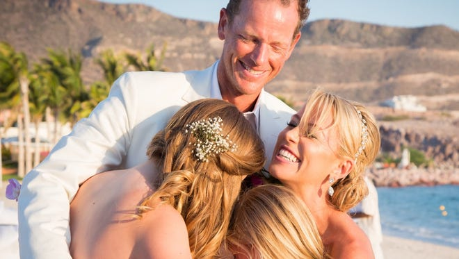 Eric Falbe, his wife, Carrie, and his daughters, Victoria (Tori) and Skylar, on his wedding day. All four died when their small plane headed to Telluride, Colorado, from Scottsdale crashed north of Payson on Jan. 2, 2017.