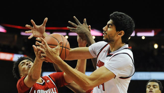 Louisville's Anas Mahmoud (right) fights for a rebound against Jordan Nwora (33) on Friday during the second Red-White scrimmage at the KFC Yum! Center. Oct. 27, 2017