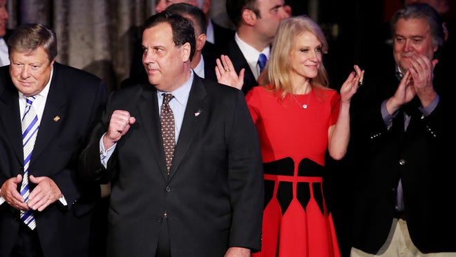 New Jersey Gov. Chris Christie, center, stands on stage along with Republican president-elect Donald Trump's campaign manager, Kellyanne Conway, and Trump campaign CEO Stephen Bannon during the election night event at the New York Hilton Midtown in the early morning hours of Wednesday, Nov. 9, 2016 in New York City.