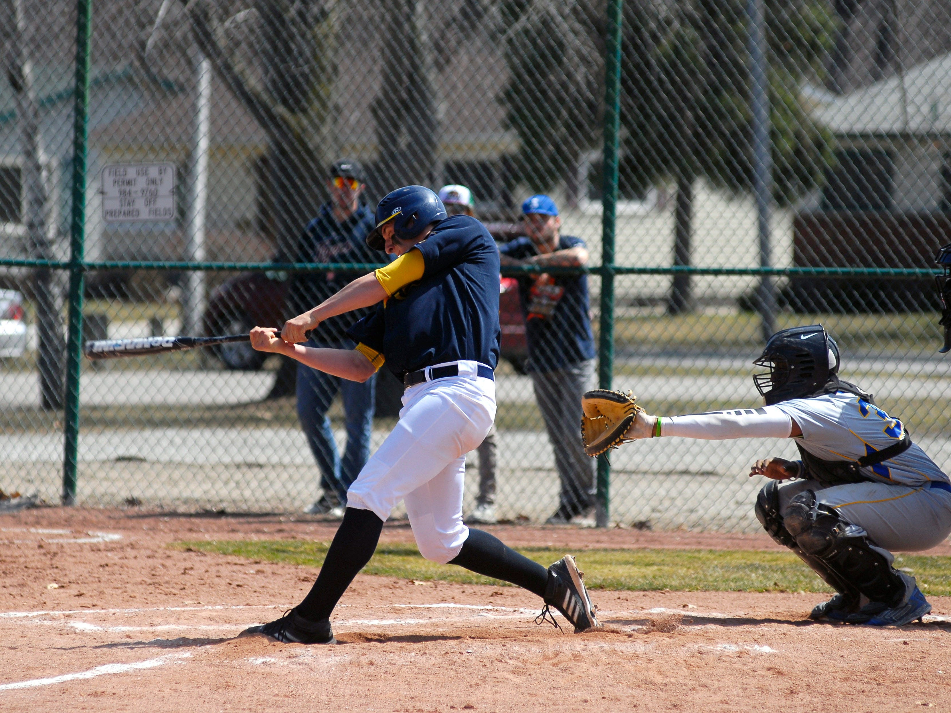 Mitchell Ward makes contact with the ball April 12, during a game against Ancilla College.