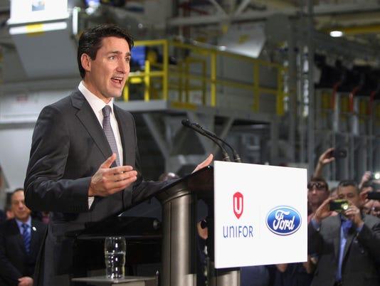 636264877032687063-AP-Trudeau-Autos-DJC102.jpg