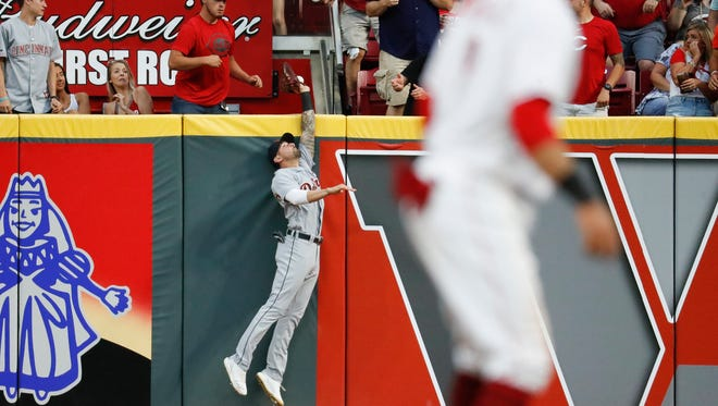 Detroit Tigers right fielder Nicholas Castellanos, left, misses a grand slam by Cincinnati Reds' Joey Votto off starting pitcher Matthew Boyd during the third inning of a baseball game Tuesday, June 19, 2018, in Cincinnati.