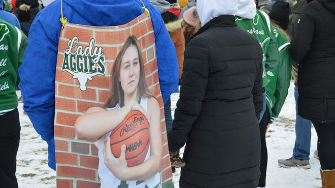 Keith Covey where a picture of his daughter, Sand Creek's Kindell Covey, during the Let Them Play play rally in Lansing on Jan. 30.