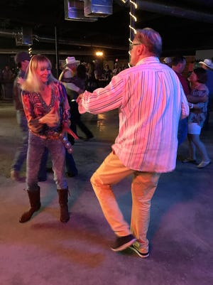 Herman and Barbara Cox, of Maastricht, Netherlands , dance to country music in the beer barn next door to the Spur Arena Saturday, July 15, 2017.