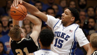 Duke Blue Devils center Jahlil Okafor (15) blocks the shot of Army Black Knights guard Kyle Wilson (21) in their game at Cameron Indoor Stadium.