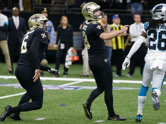 New Orleans Saints kicker Wil Lutz (3) looks up as he kicks the game-winning filed goal, during the second half at an NFL football game, Sunday, Nov. 24, 2019, in New Orleans. To the left is New Orleans Saints punter Thomas Morstead (6) and Carolina Panthers cornerback Donte Jackson (26), left. (AP Photo/Butch Dill)