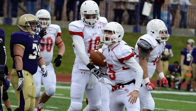 Harper Creek graduate and Olivet College quarterback Braden Black (15) is the school's all-time leader for passing yards and touchdowns.