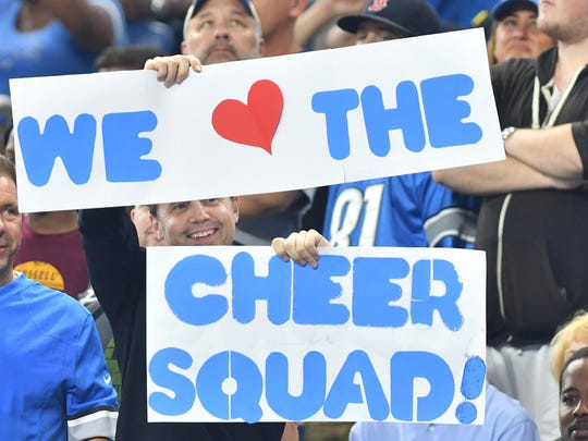 Fans show their love for the new Detroit Lions Cheerleaders in the first quarter. NFL Detroit Lions vs. Tennessee Titans at Ford Field in Detroit, Michigan on September 18, 2016. (The Detroit News/ Daniel Mears)