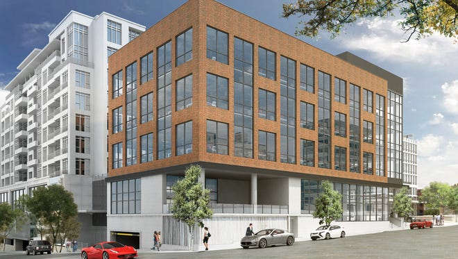 An updated rendering of a planned office building at Falls and Broad streets.