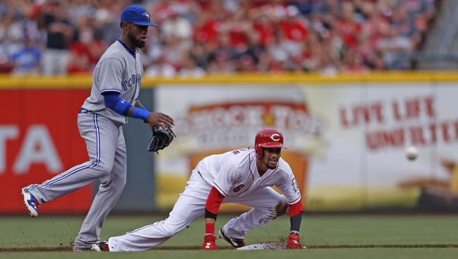 Cincinnati Reds center fielder Billy Hamilton (6) watches the ball as he is safe at second with a double off Toronto Blue Jays starting pitcher Liam Hendriks (39) during the second inning.