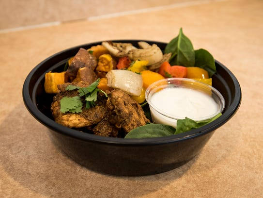 A chili lime chicken bowl sits on the counter in the