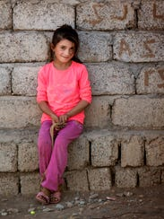 A young girl in western-style clothes in Northern Iraq.