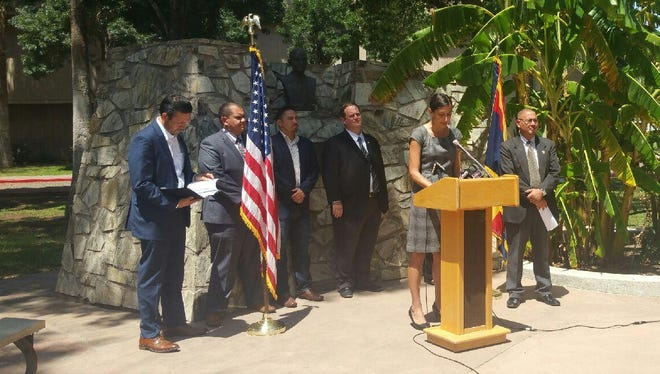 Samantha Pstross, Arizona Advocacy Network executive director, discusses Donald Trump's divisive comments at a news conference at the state Capitol in Phoenix on June 8, 2016. She was joined by Arizona Latino and community leaders.