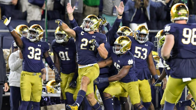 Notre Dame Fighting Irish linebacker Drue Tranquill (23) celebrates after an interception in the second quarter against the Georgia Bulldogs at Notre Dame Stadium.