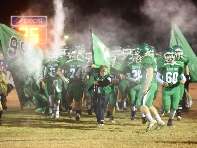 Michael Crespino leads the Panthers onto the field.