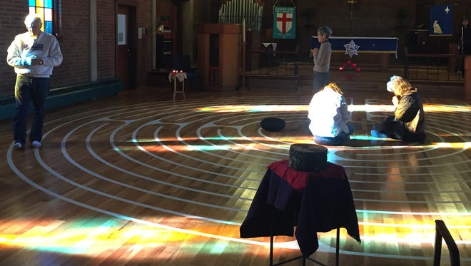 Randy Bell of Spring Creek walks through the labyrinth Saturday at St. George's Episcopal Church in West Asheville.