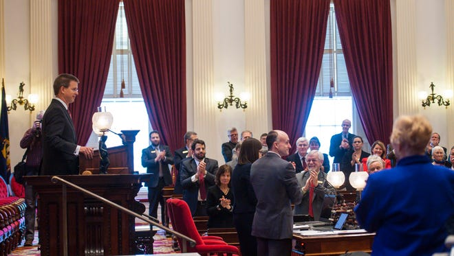 Speaker of the House Shap Smith, left, finishes his address to the House of Representatives on the first day of the Legislature at the Statehouse in Montpelier on Tuesday, January 5, 2016.