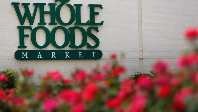"""A Whole Foods Market store in Louisville, Kentucky. The store is seeking to shed its """"Whole Paycheck"""" reputation with a new line of less-expensive markets."""