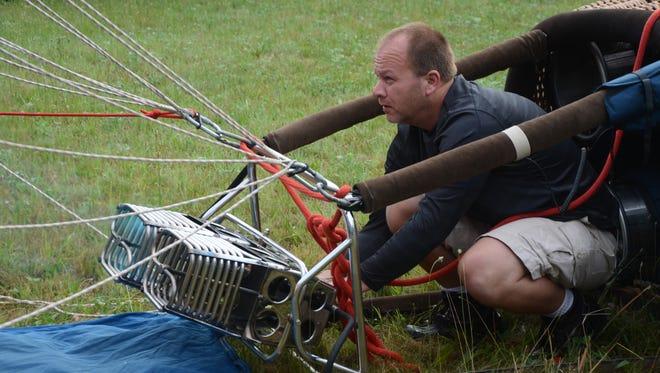 Jeff Pestun of Zeeland, the winner of the 2017 Battle Creek Field of Flight, inflates his balloon Tuesday morning.