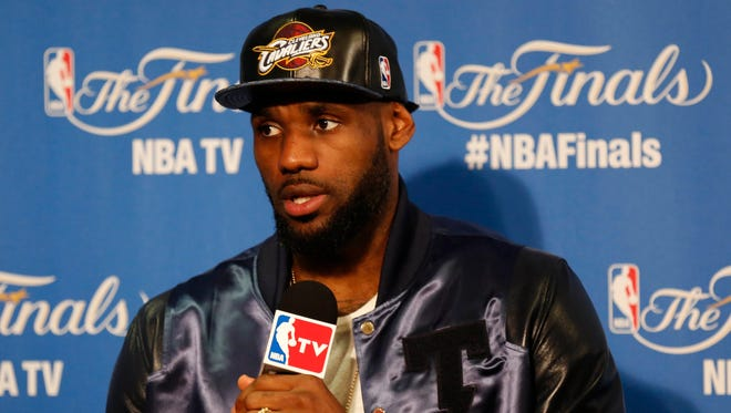 Cleveland Cavaliers forward LeBron James speaks to media following the 104-91 loss against the Golden State Warriors in game five of the NBA Finals. at Oracle Arena.