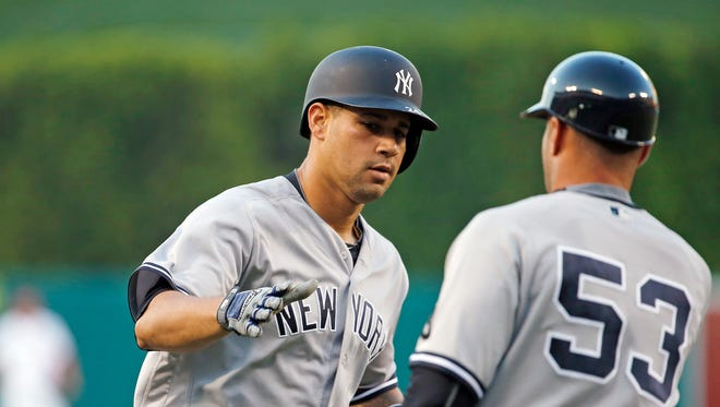 New York Yankees' Gary Sanchez, left, is congratulated by coach Joe Espada as he circles the bases on a solo home run against the Los Angeles Angels in the first inning of a baseball game in Anaheim, Calif., Saturday, Aug. 20, 2016.
