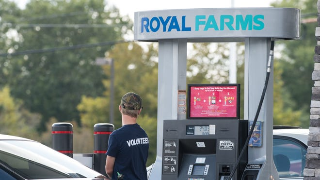 A man pumps gas at a Royal Farms on the corner of Beaglin Park Drive and Snow Hill Road.