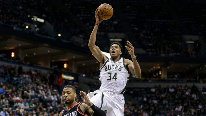 Giannis Antetokounmpo of the Bucks goes up for two of his career-high 44 points on Saturday night against the Trail Blazers at the Bradley Center.
