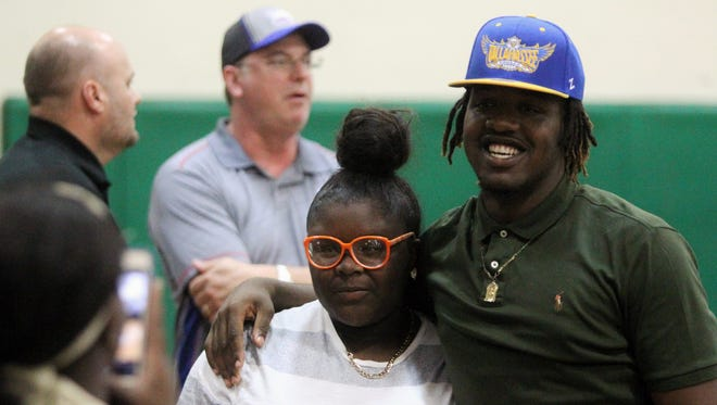 Lincoln High senior Tyler Farmer takes a photo with a friend following his signing Thursday to play basketball at TCC.