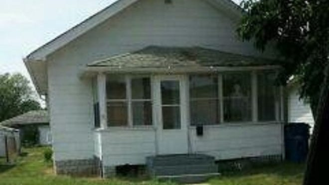 The house where Latoya Ammons lived with her family was on Carolina St. in Gary. This is a photo taken by the police.  A figure appears to show itself in the window at right.
