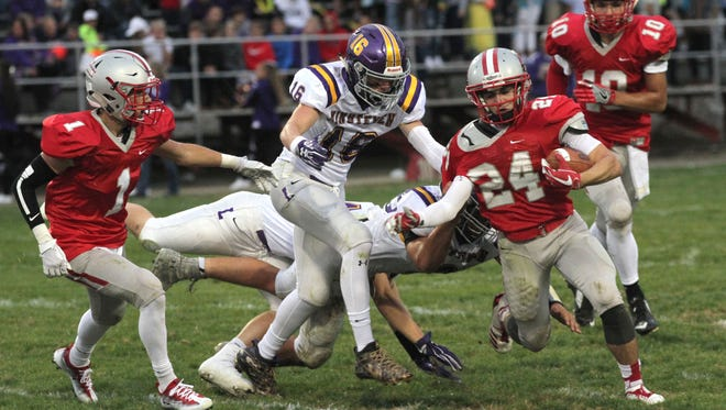 Shelby's Owen Fisher tries to out-run the Lexington defense on Friday night.