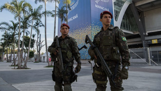 Brazilian paratroopers stand guard outside the Maracana stadium in Rio de Janeiro, Brazil ahead of the Rio Olympic Games.