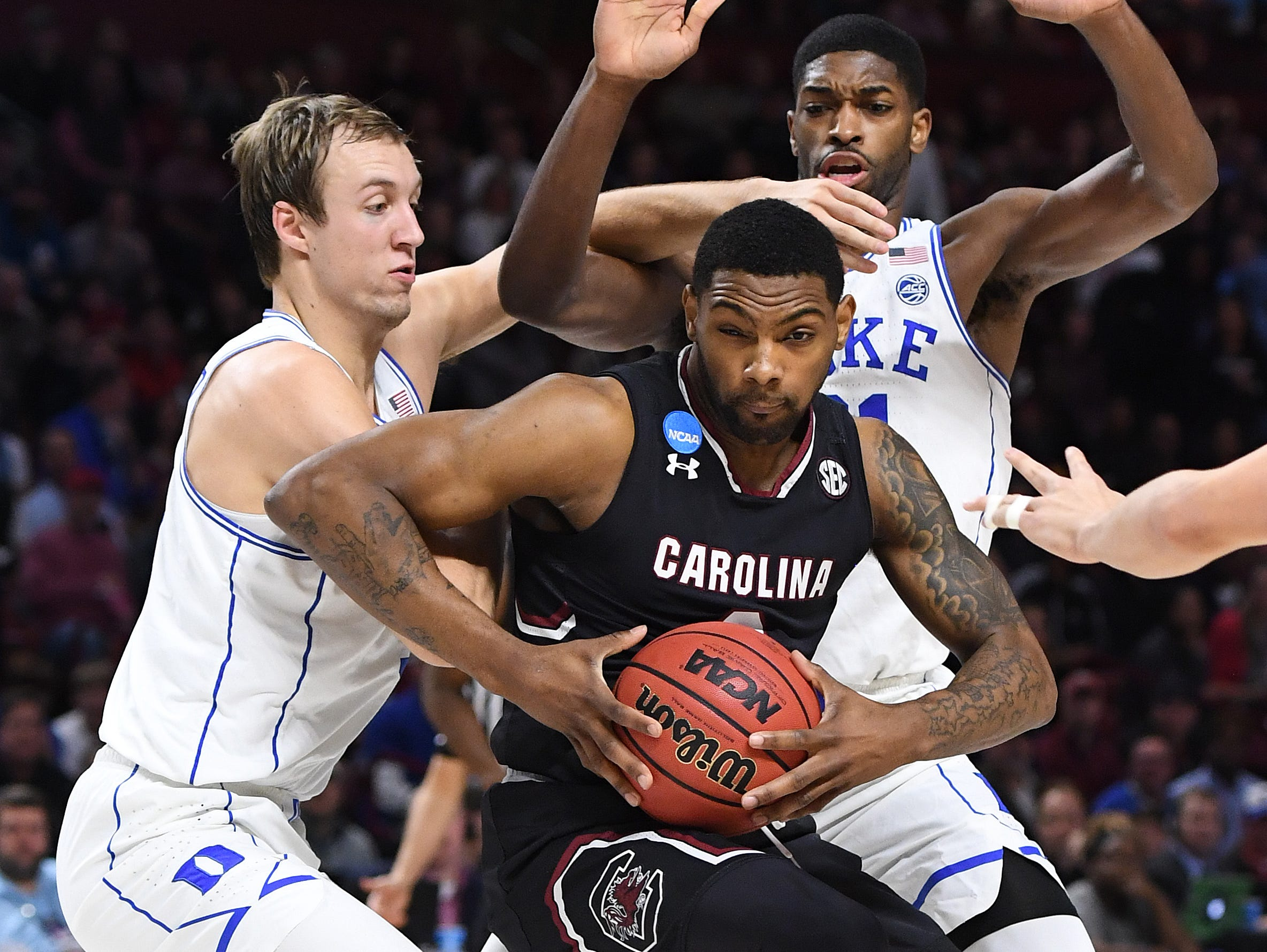 Duke guard Luke Kennard (5), left, and forward Amile Jefferson (21) guard South Carolina guard Sindarius Thornwell (0) during the 2nd round of the NCAA Tournament at Bon Secours Wellness Arena in downtown Greenville on Sunday, March 19, 2017.
