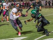 Tigers hold off Scorpions for 31-28 victory