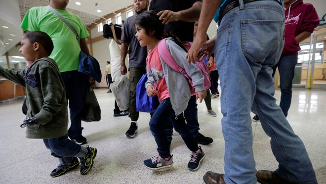 A group of immigrants from Honduras and Guatemala seeking asylum arrive at the bus station after they were processed and released by U.S. Customs and Border Protection in McAllen, Texas.
