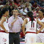 U of L head coach Jeff Walz instructs his team against Duke during their game at the KFC Yum! Center. Jan. 10, 2015