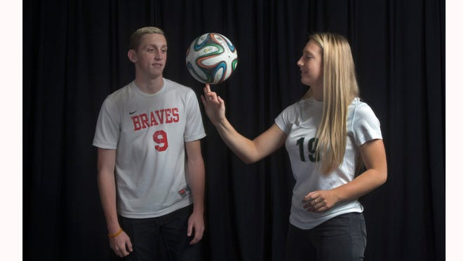 All-Shore Girls Soccer Player of the Year Frankie Tagliaferri of Colts Neck spins the soccer ball as Ryan Hammer of Manalapan watches.