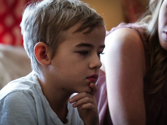Canyon Martin, 11, and his mother, Ashley Martin, talk about his condition Thursday, Dec. 21, 2017, at home. Canyon has Focal Segmental Glomerular Sclerosis and uses dialysis every night.